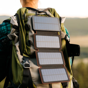 QuadraPro Solar Power Bank Charging in sun clipped to back of backpack