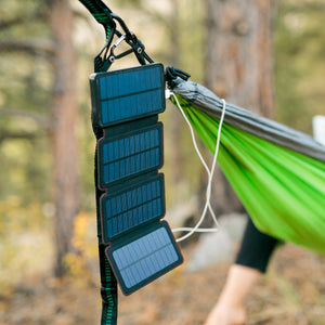 QuadraPro Solar Power Bank hanging open on a hammock