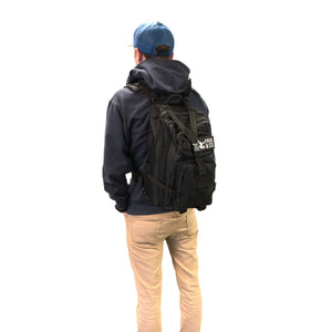 Black Tactical Backpack on man