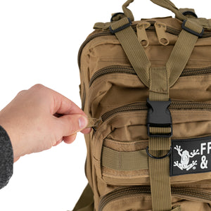 Tan Tactical Backpack close up man opening zipper