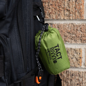 Green bivy clipped on backpack with carbiner