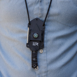 neck knife hanging around man's neck with paracord lanyard