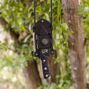 Neck Knife hanging from tree with paracord lanyard