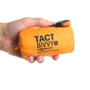 orange bivy held in left hand
