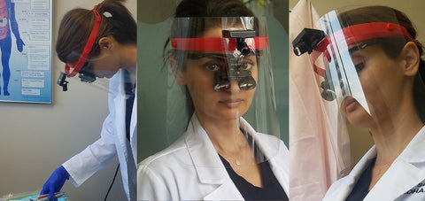 Dentist with our optical loupes attached to a face shield for the safety of your staff!
