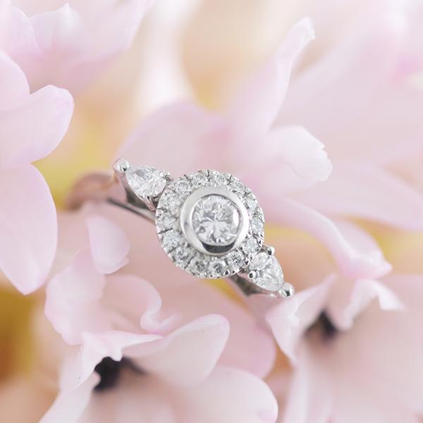 Diamond Halo Engagement Ring with Pear Side Stones set in 18k White Gold