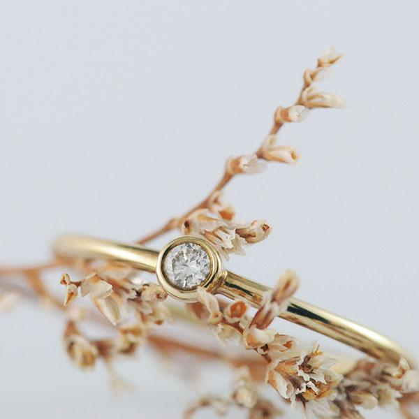 Delicate 9k Yellow Gold Bezel set Diamond ring