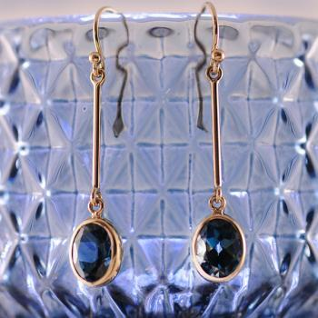 London Blue Topaz Oval Bezel Long Dangle Earrings in 9k Yellow Gold