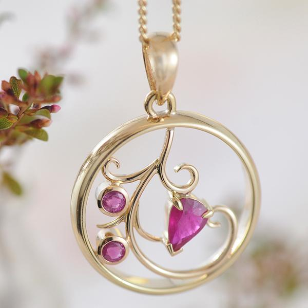 Ruby Pendant featuring Recycled Wedding Band as the frame and floral theme.