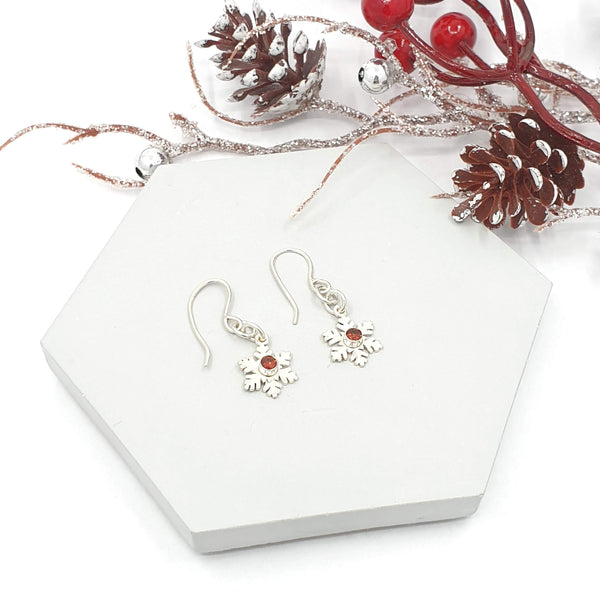 Snowflake drop earrings with garnets