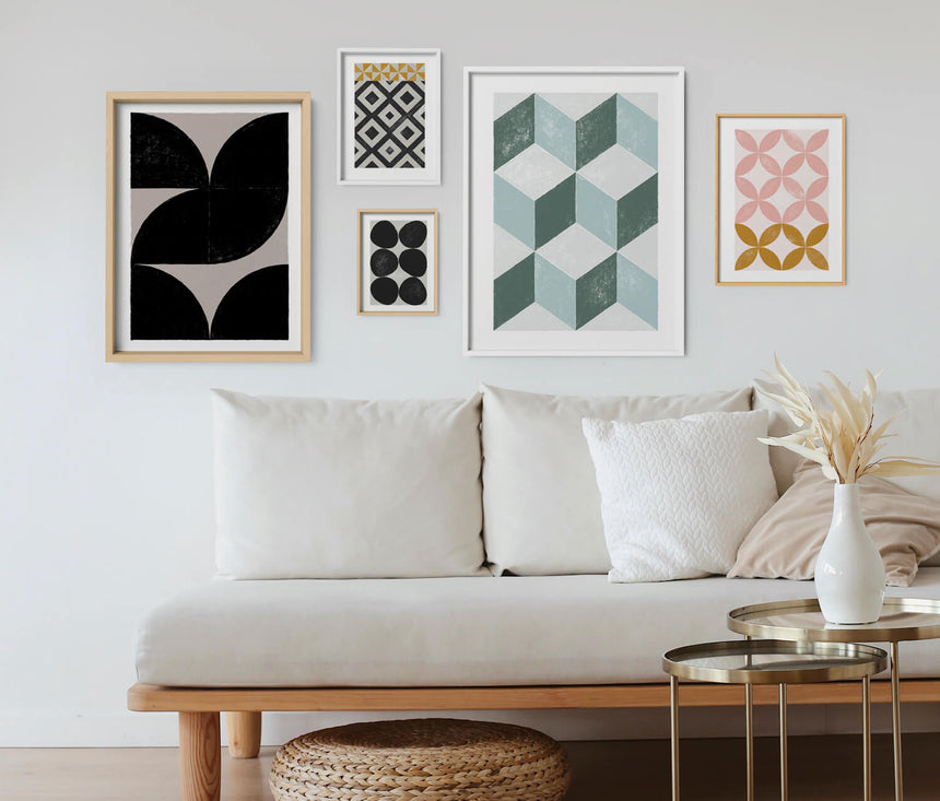 Poster gallery wall with geometric wall art and contemporary large abstract wall art in nordic living room.