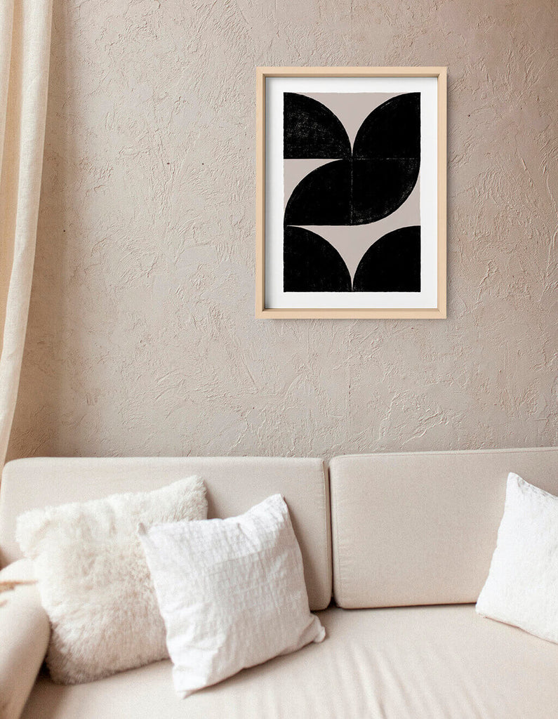 Black and white abstract wall art hanging in neutral minimalist living room
