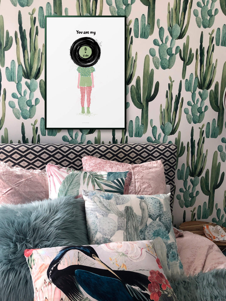 B side vinyl record music wall art hanging in cool and eclectic bedroom above bed.