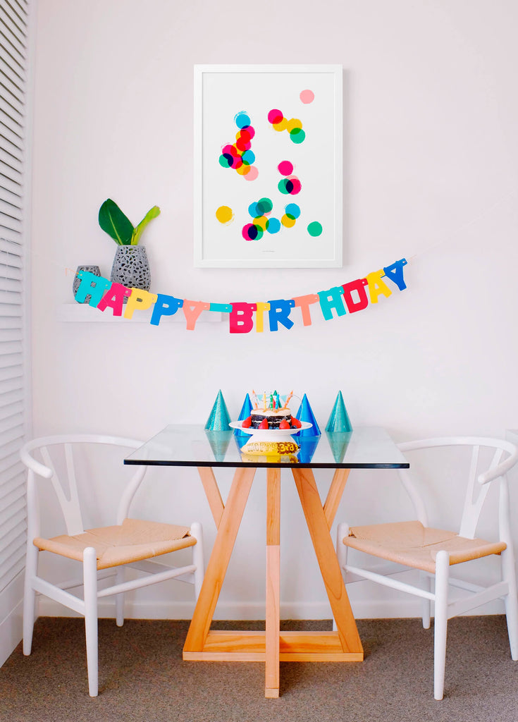 confetti wall art, colorful and bright wall art hanging in fun dining room