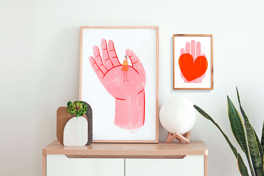Graphic art prints by Just Cool Design. Illustration print of hand holding woman and hand holding red heart wall art print in women bedroom.
