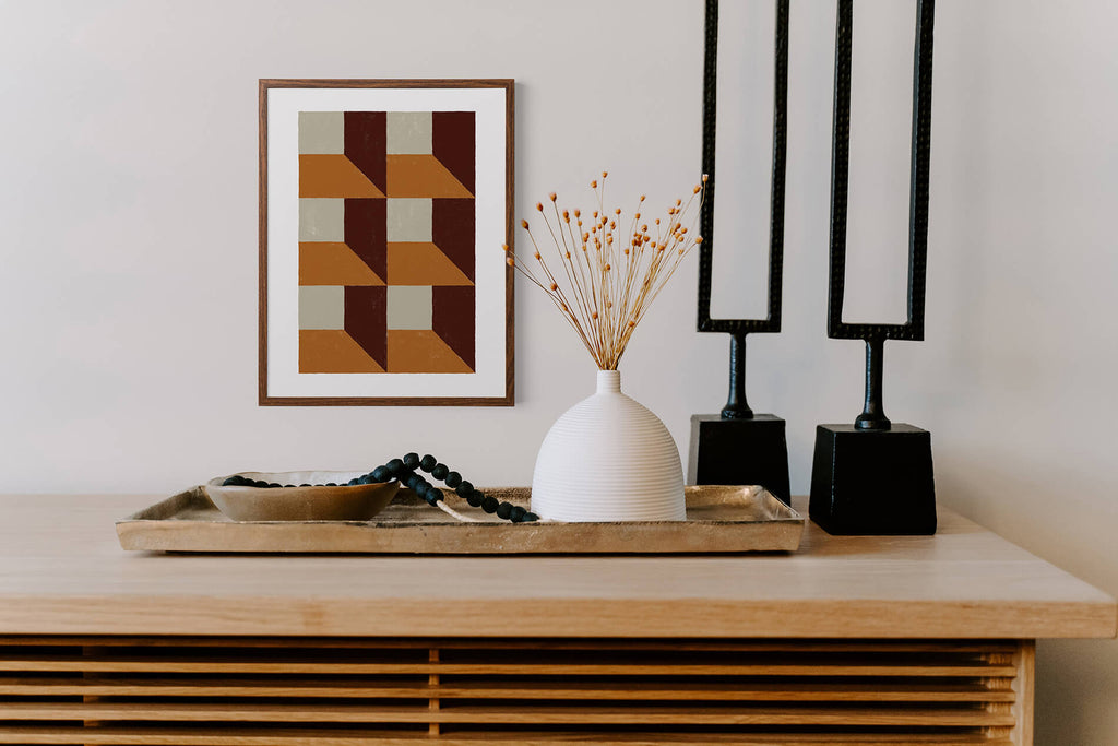 Orange and brown geometric pattern wall art in mid century modern living room, abstract tiles print