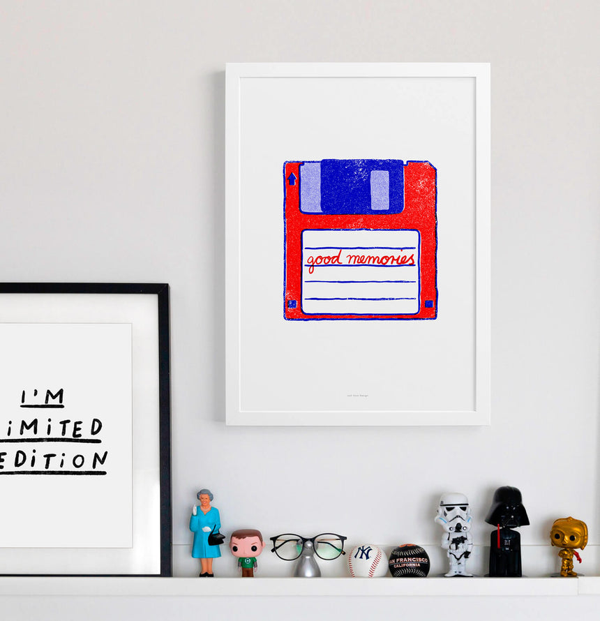 "Nerd wall art and geek wall art in modern interior with little geek toys. Floppy disk art in red and blue and the quote ""good memories"". modern colorful wall art."