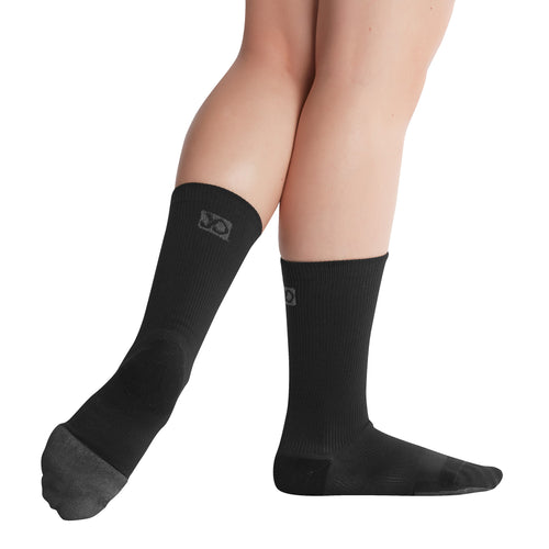 Female model wearing APOLLA Infinite Mid Calf Recovery Socks. Style: Infinite. Color: Black. View: Side, Back.