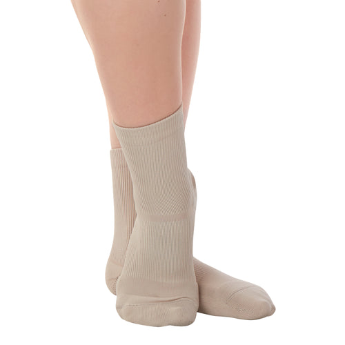 Female model wearing APOLLA Performance Crew Support Socks. Style: Performance. Color: Nude 1. View: Front, Side.