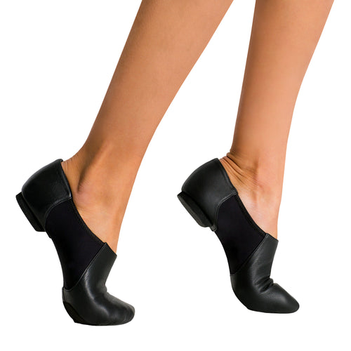 Female model wearing CAPEZIO Hanami Wonder Jazz Shoe, Style: CG30W, Color: Black, View: Side.