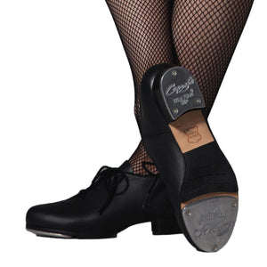 Female model wearing Capezio Cadence Tap shoe, shown in black.