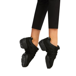 Female model wearing Capezio Rock It Dansneaker, style SD24C, color black.