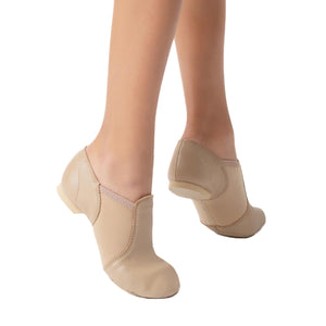 Female model wearing  Capezio Jazz Slip On Shoe, style EJ2, colour black, side & bottom view.