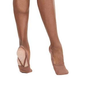 Product image showing female wearing Capezio Hanami Pirouette shoe, shown in color light suntan.