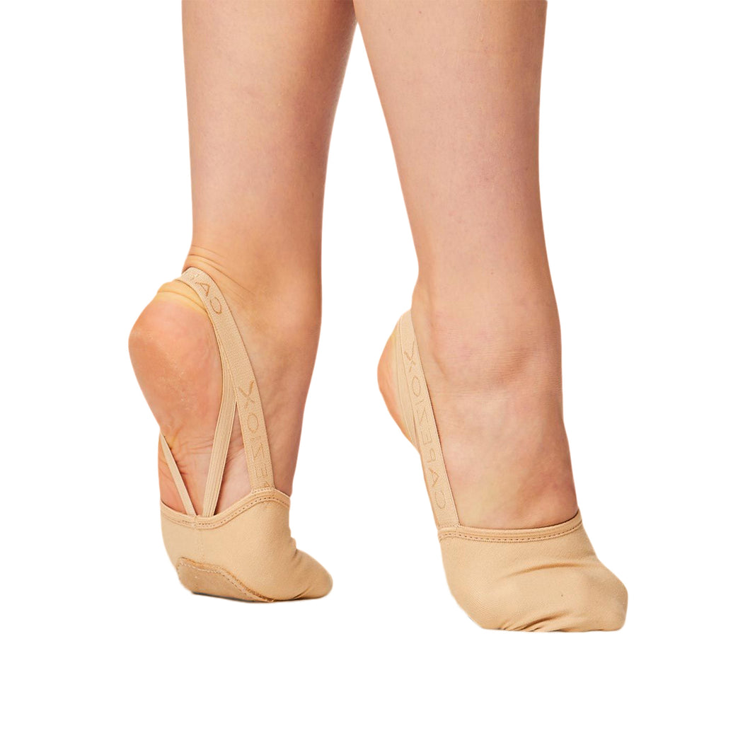 Product image showing female wearing Capezio Hanami Pirouette shoe, shown in color nude.