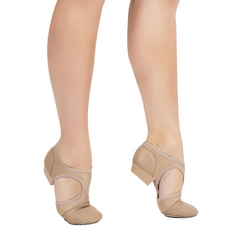 Female model wearing Capezio Pedini Femme Shoe, style PP323, colour caramel, side view.