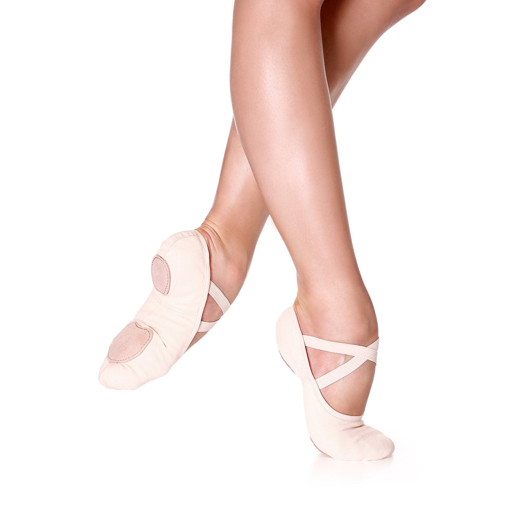 Female model wearing So Danca Stretch Canvas Split Sole Ballet Slipper, shown in light pink.