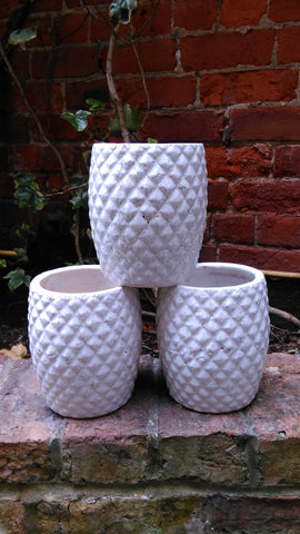 Cracked white ceramic pot
