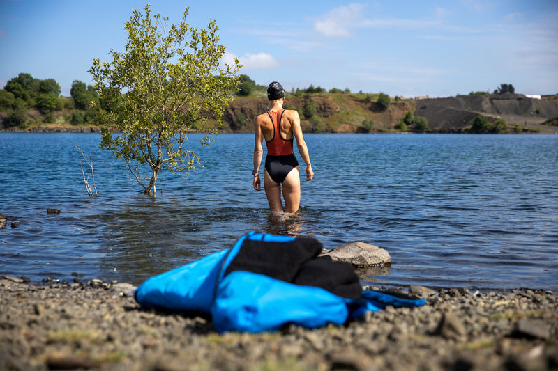 Joanna Shimwell walking in to a lake in her swimming costume