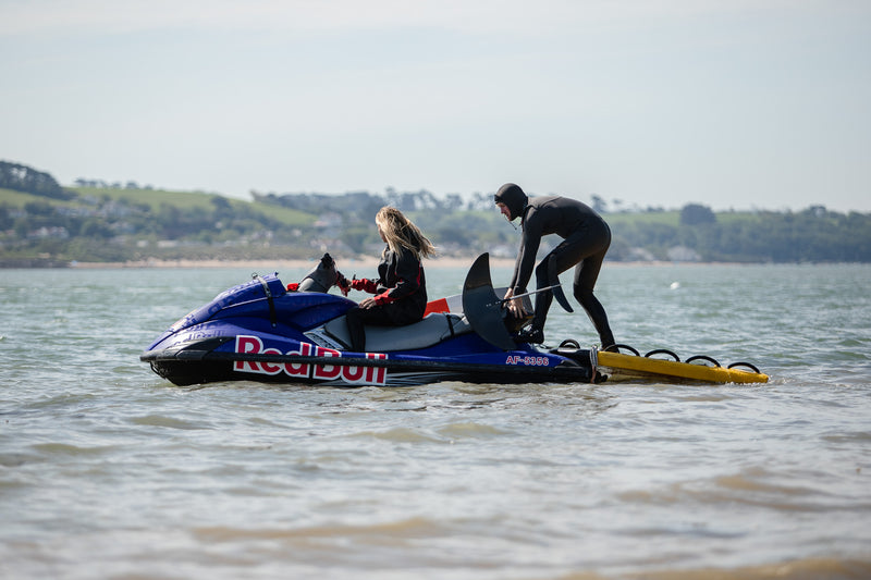 Andrew Cotton on a jet ski on the water ready to go foiling