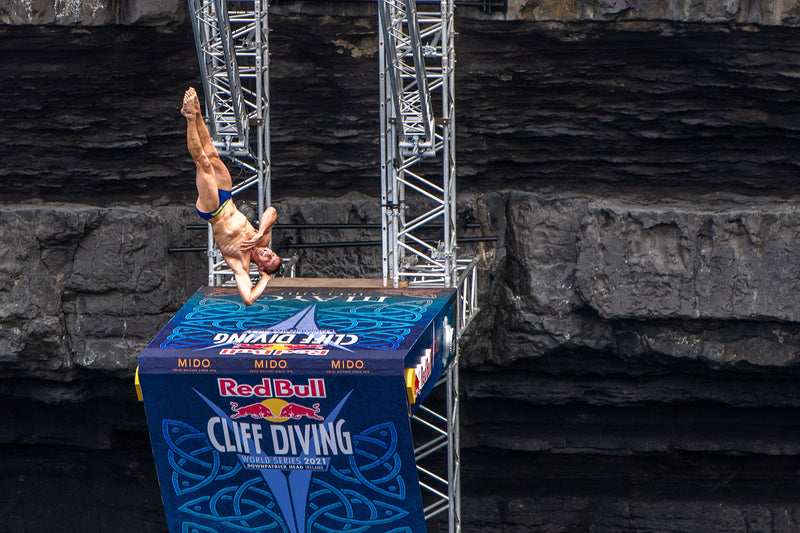 Male cliff diver diving at the Red Cliff Diving World Series 2021