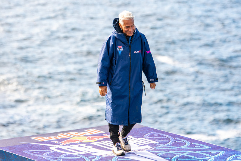 Greg Louganis wearing a dryrobe® Advance stood on the diving board at the Red Bull Cliff Diving World Series 2021