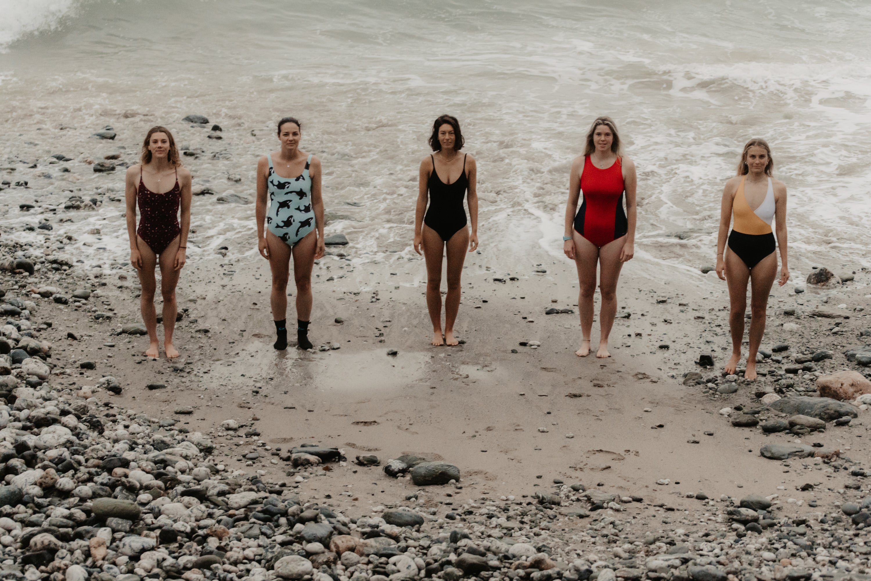 Keri-anne Payne, Lucy Campbell, Grace Kingswell and Anna Blackwell in swimsuits by the sea