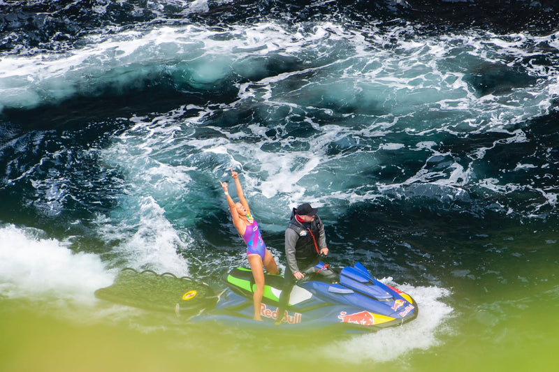 Rhiannan Iffland celebrating on a jet ski after her winning dive at the Red Bull Cliff Diving World Series 2021
