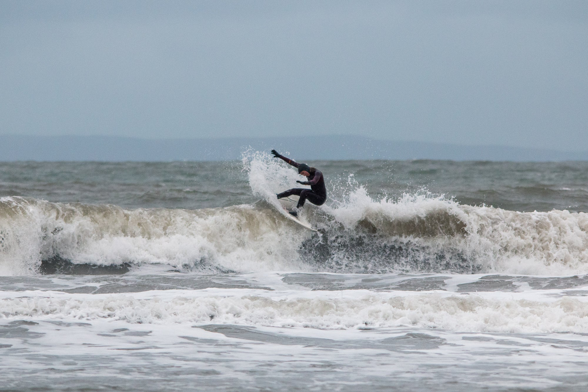 Lucy Campbell surfing at Croyde Beach