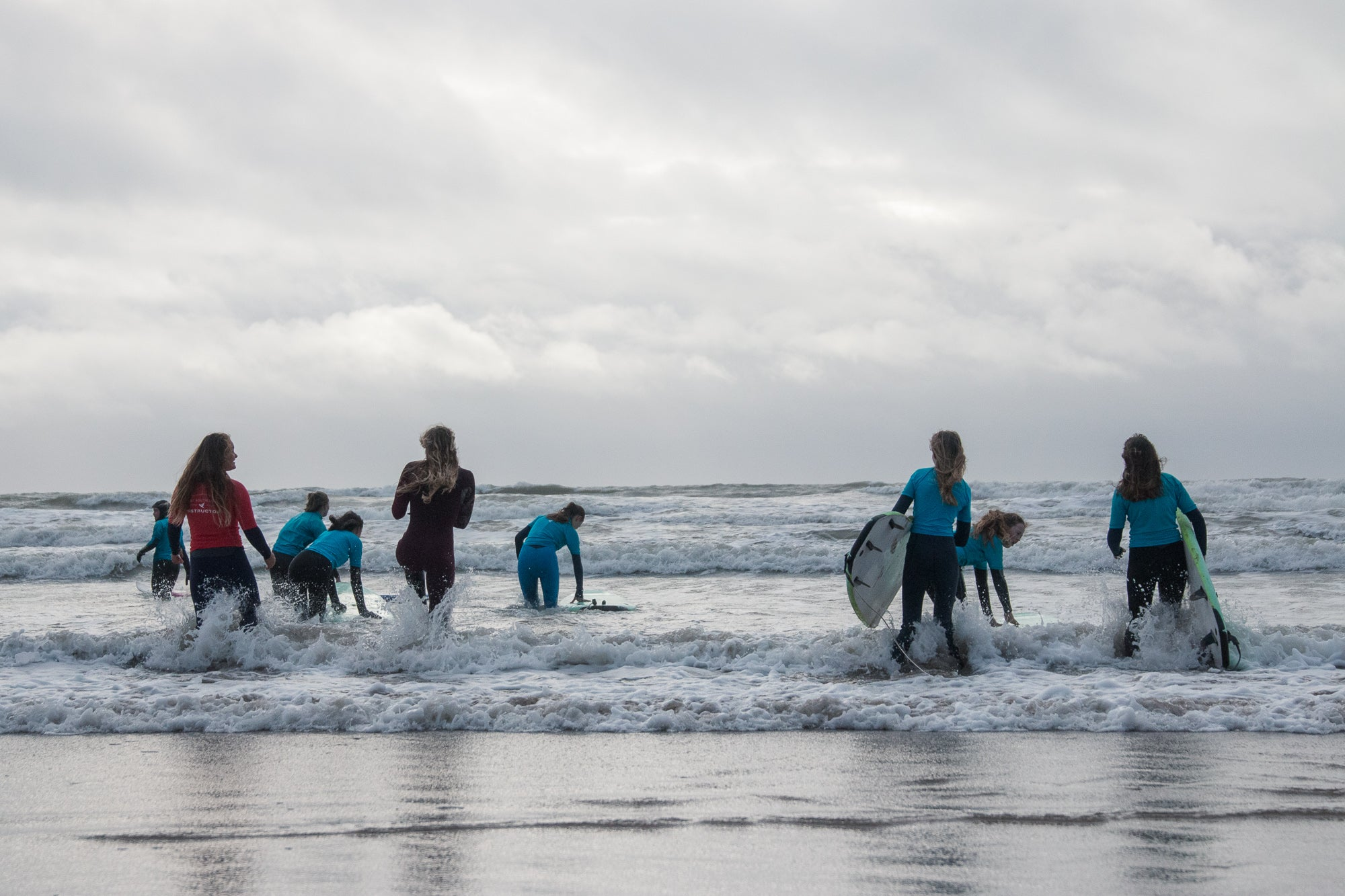 Lucy Campbell taking a surf lesson with Wave Wahines at Croyde