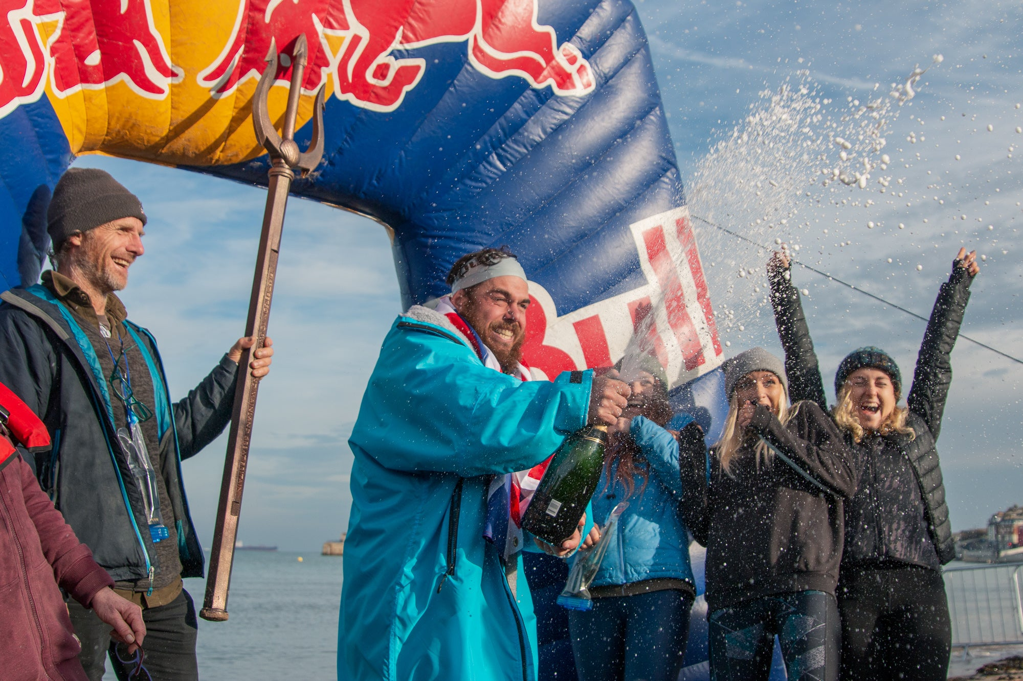 Ross Edgley celebrates completing his Great British Swim in his dryrobe