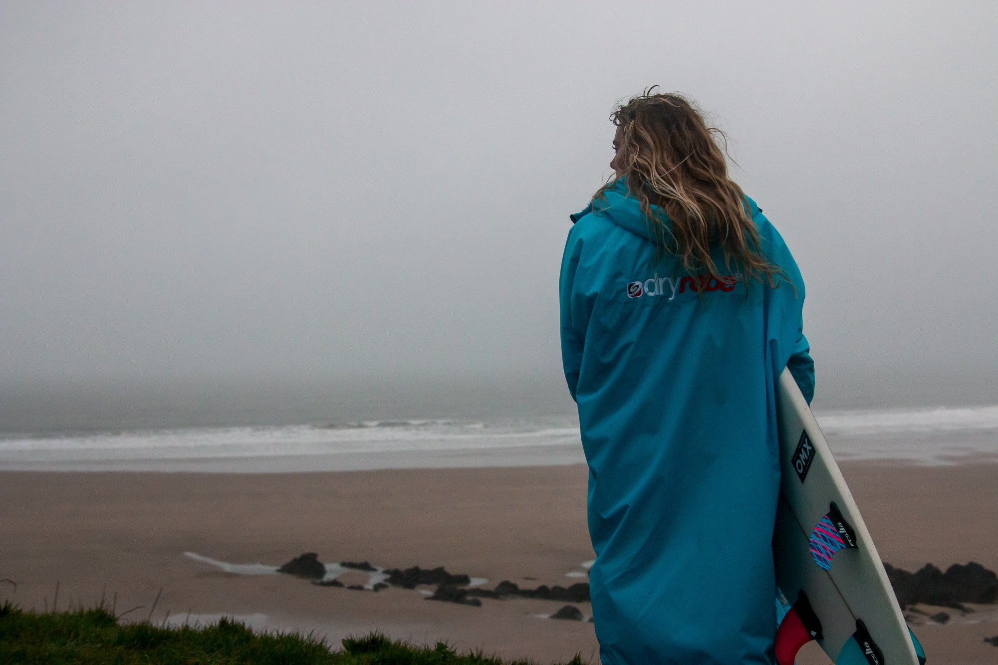 English Women's Surf Champion Lucy Campbell getting ready to surf