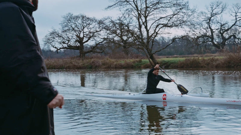 Jack Eyers paddling a canoe in a river