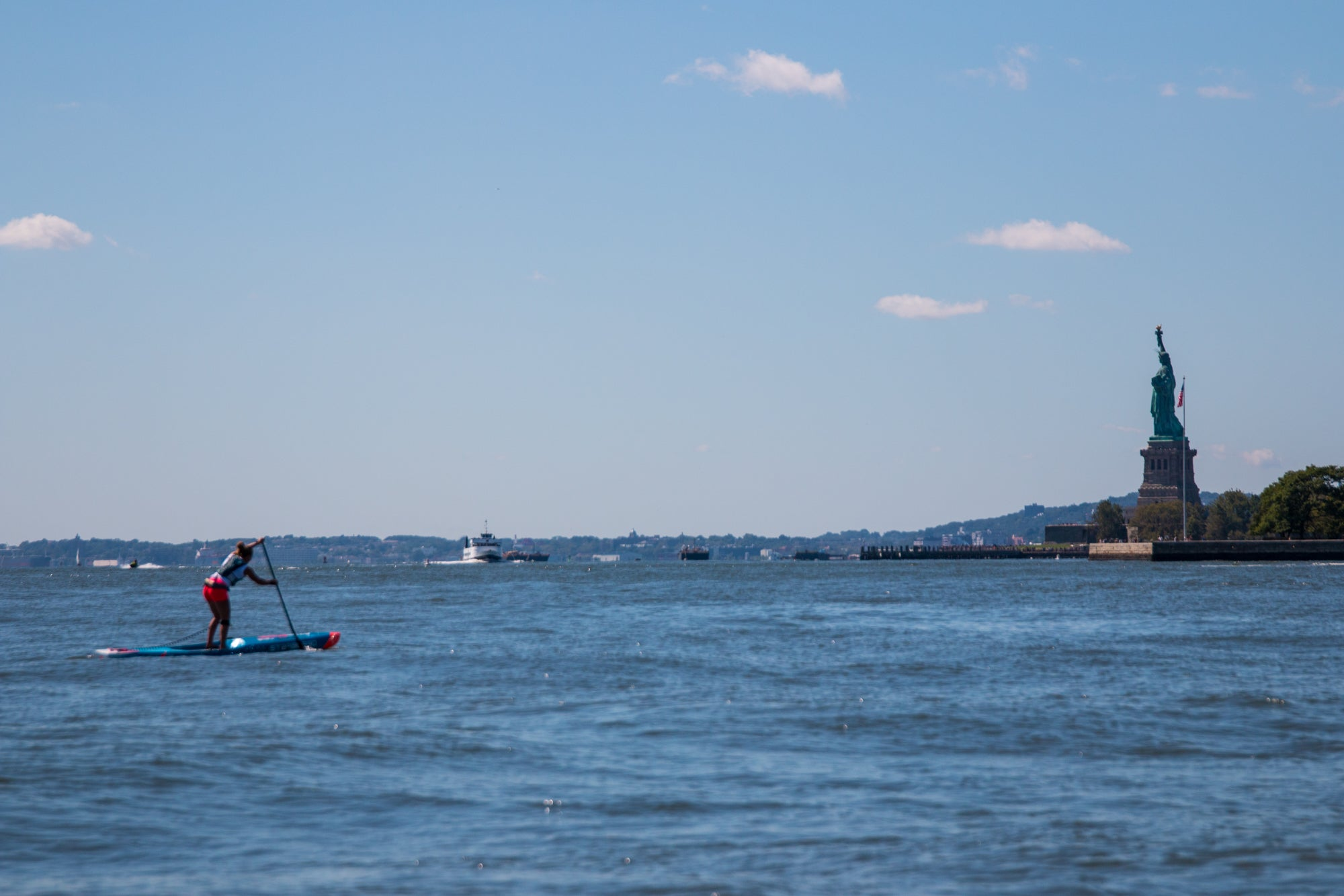 SUP racing in front of the Statue of Liberty - NY SUP Open APP World Tour 2019