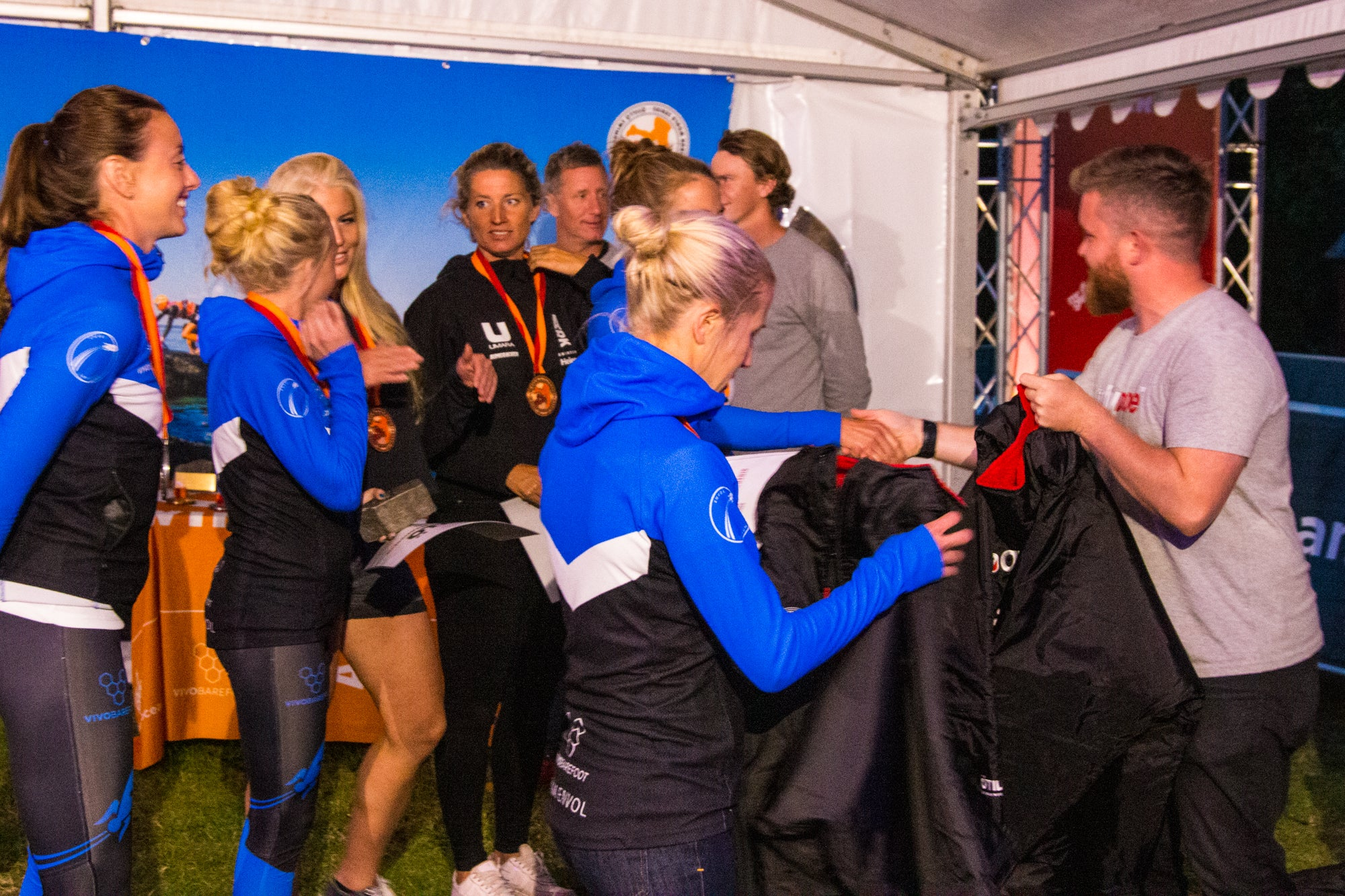 Winning women's teams collecting their ÖTILLÖ dryrobe prizes - ÖTILLÖ Swimrun World Championship 2019