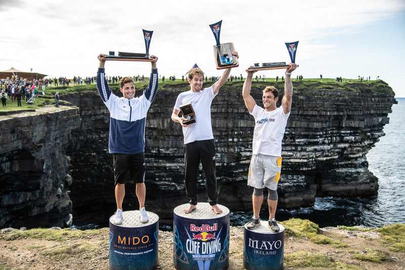 The men's winners podium at the Red Bull Cliff Diving World Series 2021
