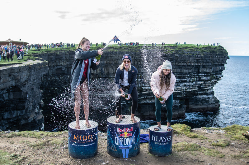 The women's winners podium at the Red Bull Cliff Diving World Series 2021