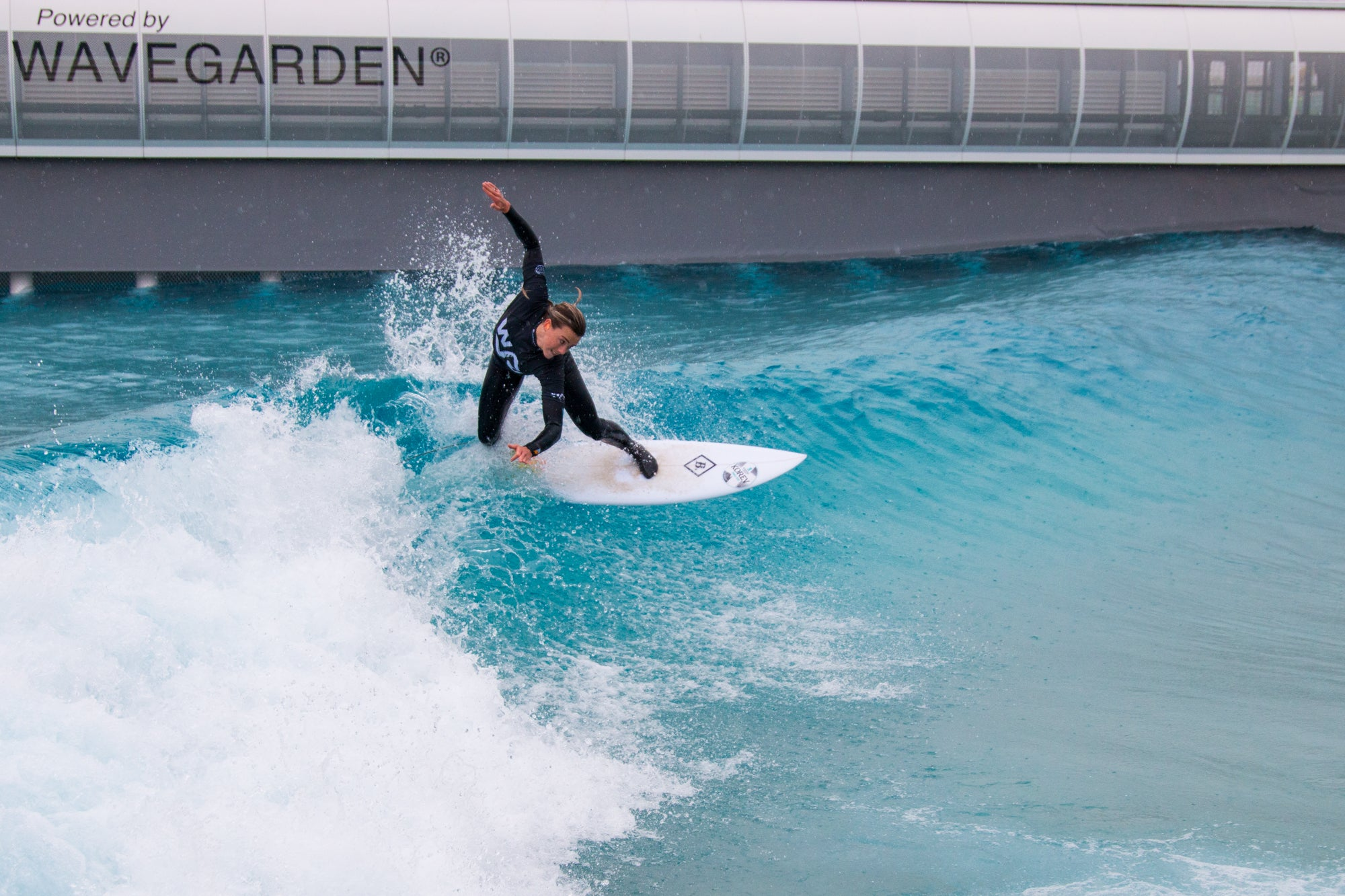 Lucy Campbell surfing at The Wave in Bristol