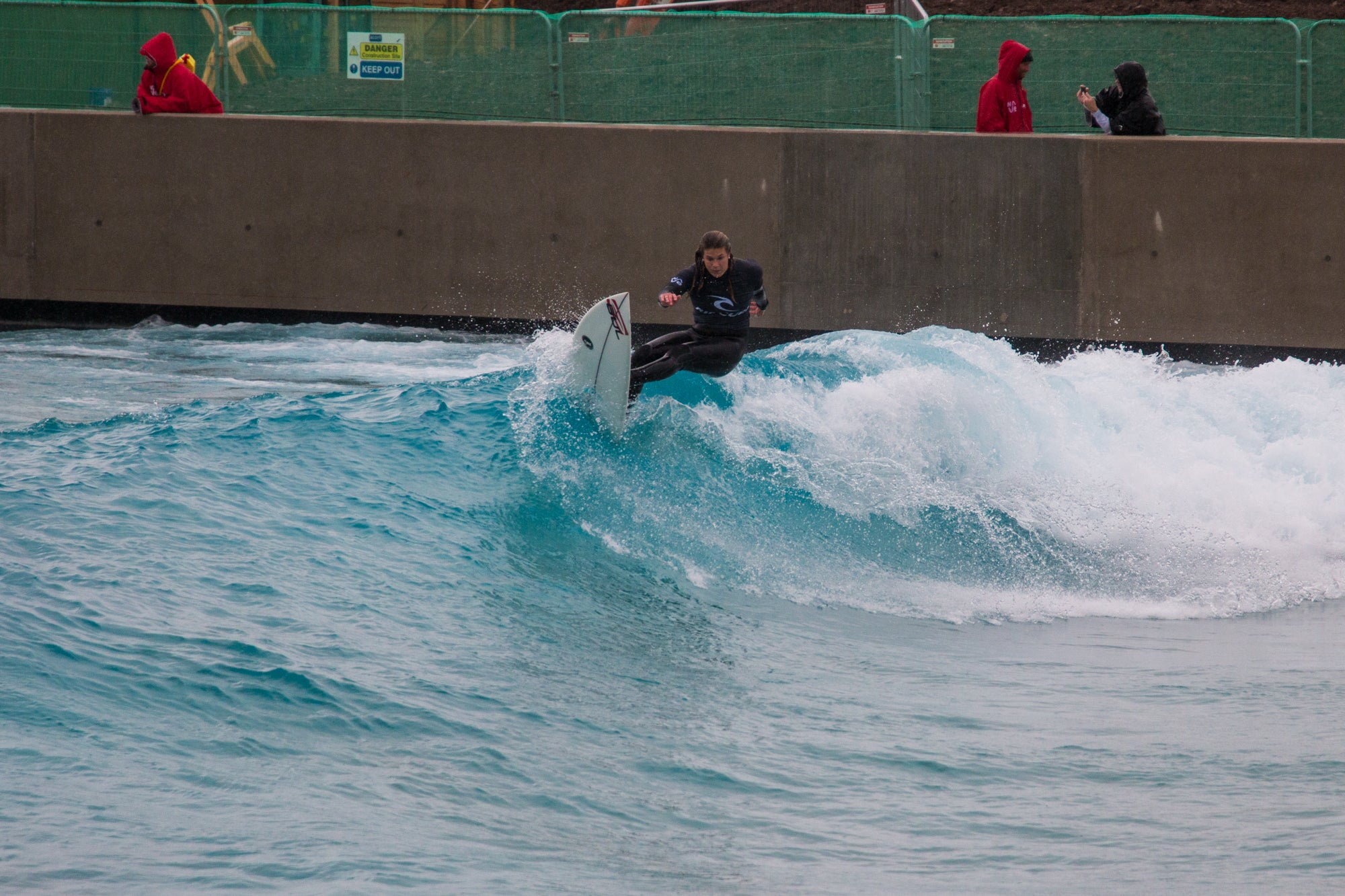 Emily Currie surfing The Wave in Bristol