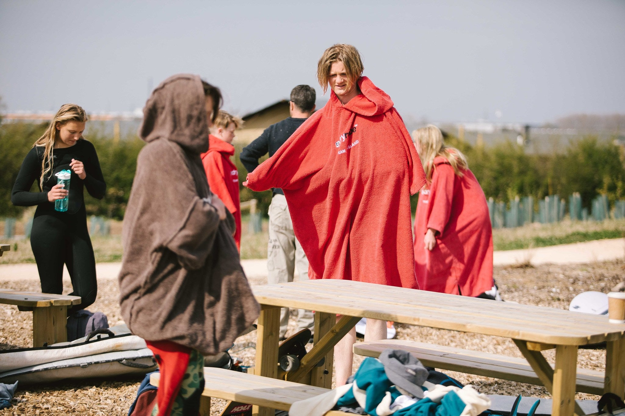 Team England Junior Squad members getting changed in Towel dryrobes